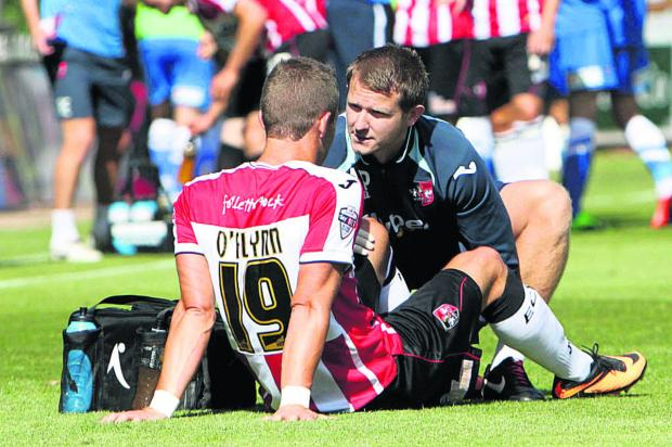 Herald Series: Andrew Proctor (right) in action as Exeter's physio