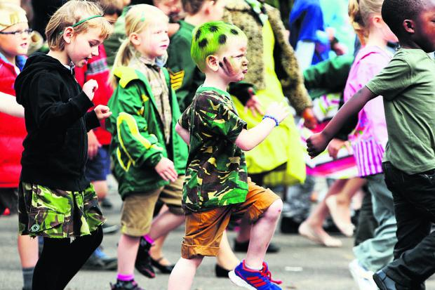 Carswell School pupils, including Ayaan Vivien – with the green hair – on parade