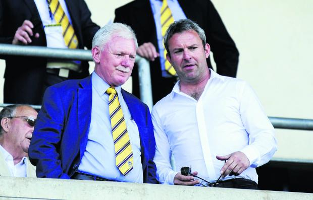 Oxford United owner Ian Lenagan with Simon at a U's game last season