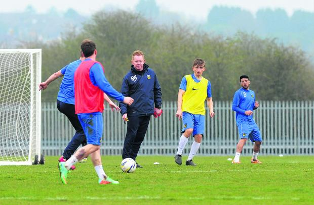 Gary Waddock will be back on the training ground with his Oxford United players when they report for pre-season today