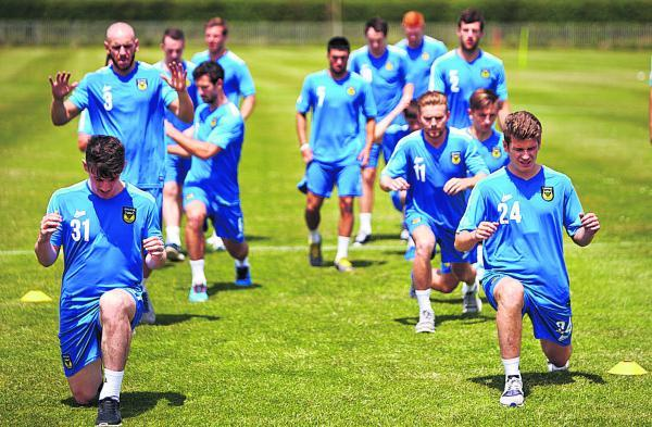Oxford United's players began their preparations for the new  season this week (above), but as it stands Johnny Mullins (
