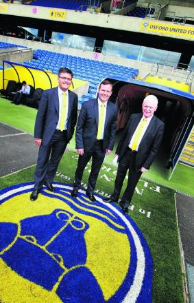 Darryl Eales (left), Mark Ashton and Ian Lenagan walk out of the Kassam Stadium tunnel after yesterday's press conference