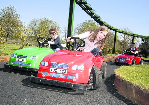 Track fun . . . Children enjoy the mini cars