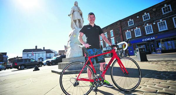 Herald Series: Gareth Hudson, who works at Ridgeway Cycles, in Wantage Market Square with a £3,000 carbon fibre Trek road bike. He is looking forward to the Tour of Britain