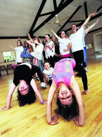 Lilly Croft, nine, Sandy McMeekin, six, and Rosie McMeekin, eight, take centre stage at the danceathon. Picture: OX68281 David Fleming