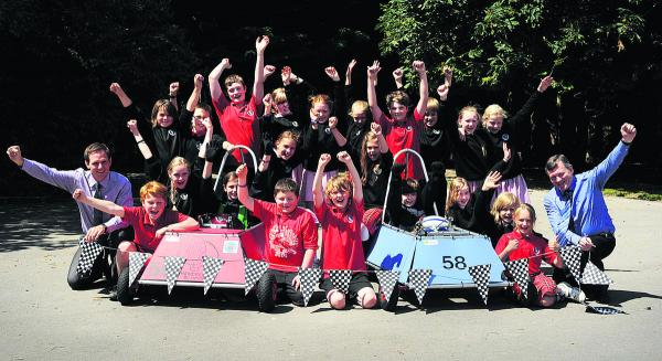 A team of children from The Hendreds Primary School took on more than 70 teams from around the country racing their electric cars at Goodwood. The group are pictured with teachers Jamie Veness, left, and Chris Sava