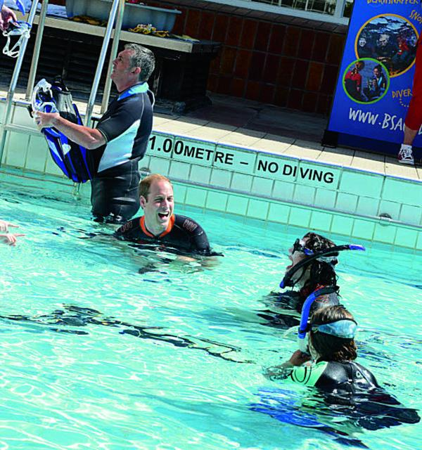 Amelia White, front right, snorkelling with Prince William