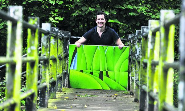 Artist Patrick Cannon with his painting called A Forest's Opening