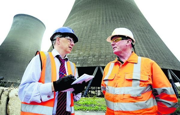 Andrew Ffrench, left, hears about the demolition plans from explosives engineer John Turner