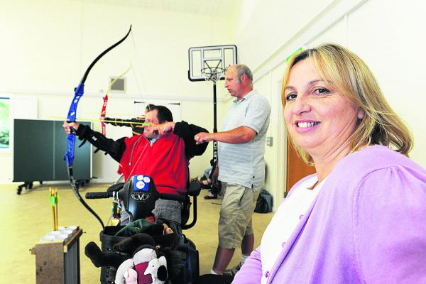 SOCIAL OUTLET: Jenny Bennett with Mark Lee, left, and archery instructor Neil Holt