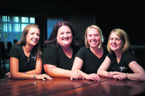 Four members of the RAF Brize Norton choir, from left, Emmeline Maline, Marie Lornie, Claire Wilkinson and Katrina Strathearn. Picture: OX68911 Andrew Walmsley
