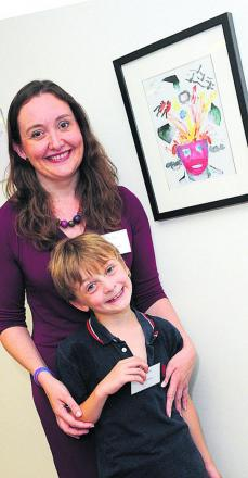 Sonia Whymark with son Ben and his painting at the Child Brain Injury Trust Celebration at the Saatchi Gallery in London