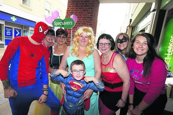 Staff and volunteers at Specsavers in Abingdon who dresssed as princesses and superheroes for the fundraiser. From left: Hayden Wheable, Megan Harries, Lorraine Robinson, Charlotte Dackombe with her son, Jake, six; Penny Heath, Amy Wyatt and Mega