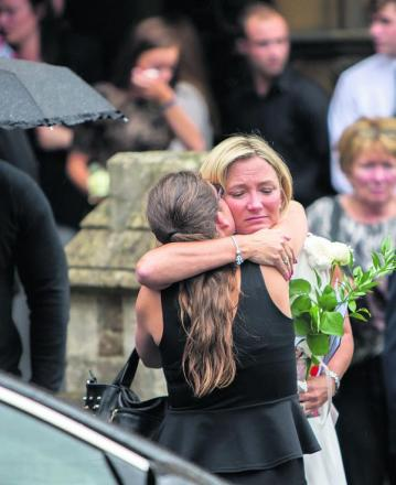 Louise Bates, the mother of Jordan Tabor is comforted after the service.    Pictures: OX69085 Damian Halliwell