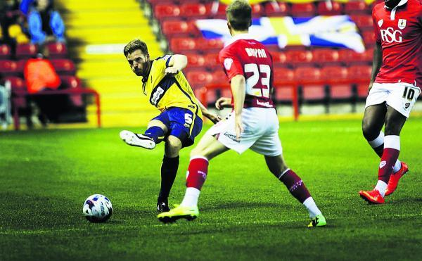 Johnny Mullins plays the ball forward against Bristol City on Tuesday night	  Pictures: Ed Nix Order no: OX69170