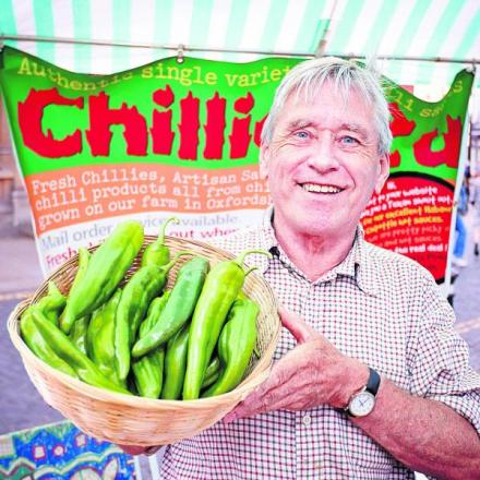 Ian Paxton, who farms chillis in Church Hanborough, holding a bo