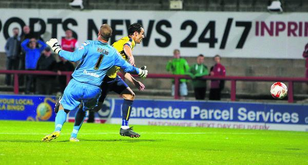 Danny Hylton is fouled by Barry Roche, but is booked for diving