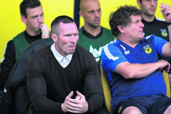 Michael Appleton looks on