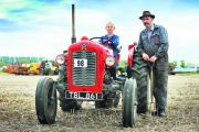 Archie Reardon gets to grips with a 1959 Massey Ferguson with owner Derek Yates Picture: OX70268 Jon Lewis