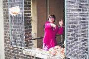 Abingdon Mayor Angela Lawrence throws buns to crowds below to celebrate the fire station's 50th anniversary