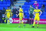 DEJECTION: From left, Oxford United's Danny Rose, Joe Riley, Ryan Clarke and Johnny Mullins cannot hide their disappointment as Max Power's goal sends them out of the FA Cup