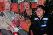 Pc Beverley Kaur delivering the Christmas hampers to Didcot Health and Wellbeing Centre visitors Roy Smirk, 97, and Miriam Porrett, 84