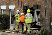 Fire crews assess the damage to the house in Mill Street, Wantage. Picture: David Fleming