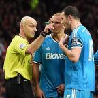 Herald Series: Referee Roger East, left, insists it was not a case of mistaken identity when he sent off Wes Brown, centre, rather than John O'Shea, right