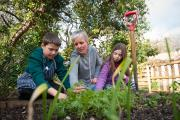 Outdoors: From left, James Lynn, 11, headteacher Lee Ryman and Paige Green, 10
