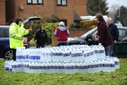 Thames Water pictured handing out bottles of water to residents earlier this week