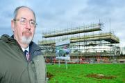 Cherwell District Council leader Barry Wood outside the eco-town development