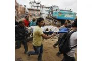 The body of a victim is recovered from the debris of a building that collapsed after the quake in Kathmandu (AP)