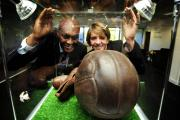 Showcase: Ex-Wimbledon striker Marcus Gayle and Liz Verrall, chief executive of the Berks and Bucks FA, look at one of the exhibits in the new offices