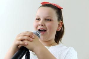Young singer uses her first single to raise money for children's charity