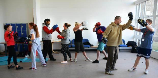 Coaches work with trainees at a Boxercise class in Rectory Road, Oxford