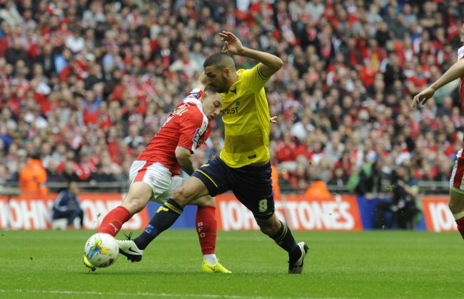 Liam Sercombe drives upfield during Oxford United's 3-2 defeat to Barnsley in the Johnstone's Paint Trophy final Picture: David Fleming