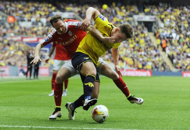 Alex MacDonald battles for the ball during Oxford United's 3-2 defeat to Barnsley in the Johnstone's Paint Trophy final at Wembley last Sunday