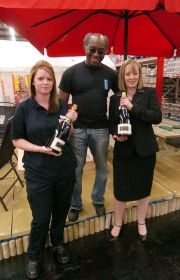 Booker store manager Michelle Guy, with customers George Smith and Victoria Gate