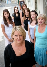Erika Oswin, front, with her staff at Oxford International College of Beauty