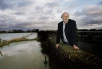 Herald Series: Farmer John Hook with flooded fields at Cote, near Bampton