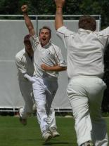 Great & Little tew bowler Anthony Smith  celebrates taking one of his five wickets against Shipton-under-Wychwood