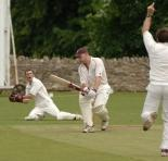 Witney Mills batsman Ross Morgan is adjudged to be caught by Nondies keeper Jonathan Guthrie (left),