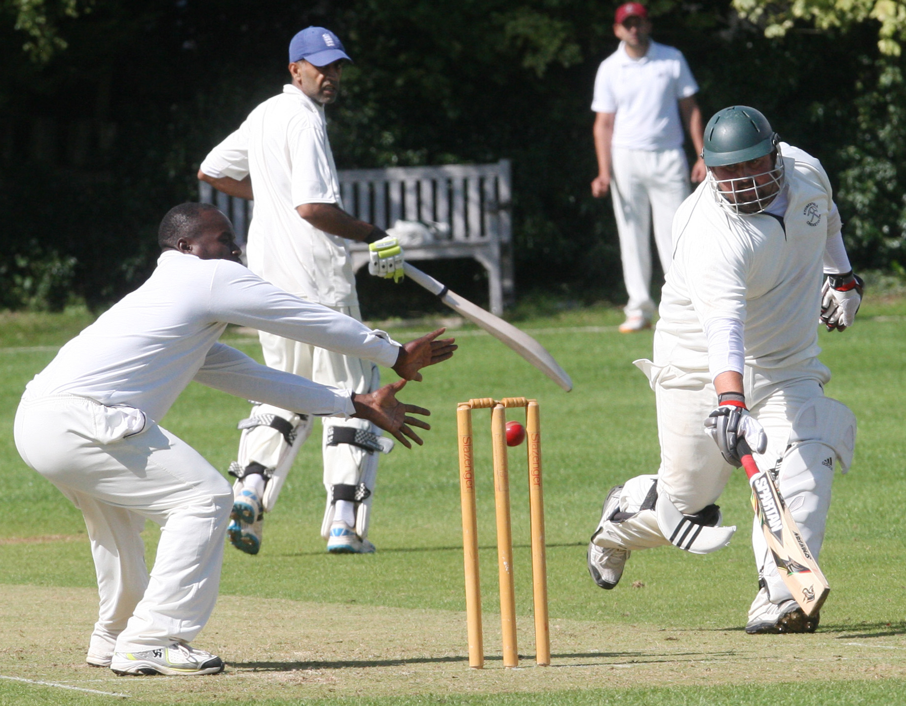 NOT OUT: East & West Hendred's Carl Palmer comes close to running out Sean Holley but the Stonesfield batsman gets home just in time                Picture: Steve Wheeler