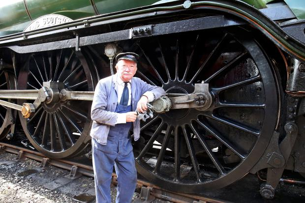 Herald Series: Grahame Dryden a volunteer at Didcot, was on the footplate as The Flying Scotsman arrived. Picture: Ric Mellis