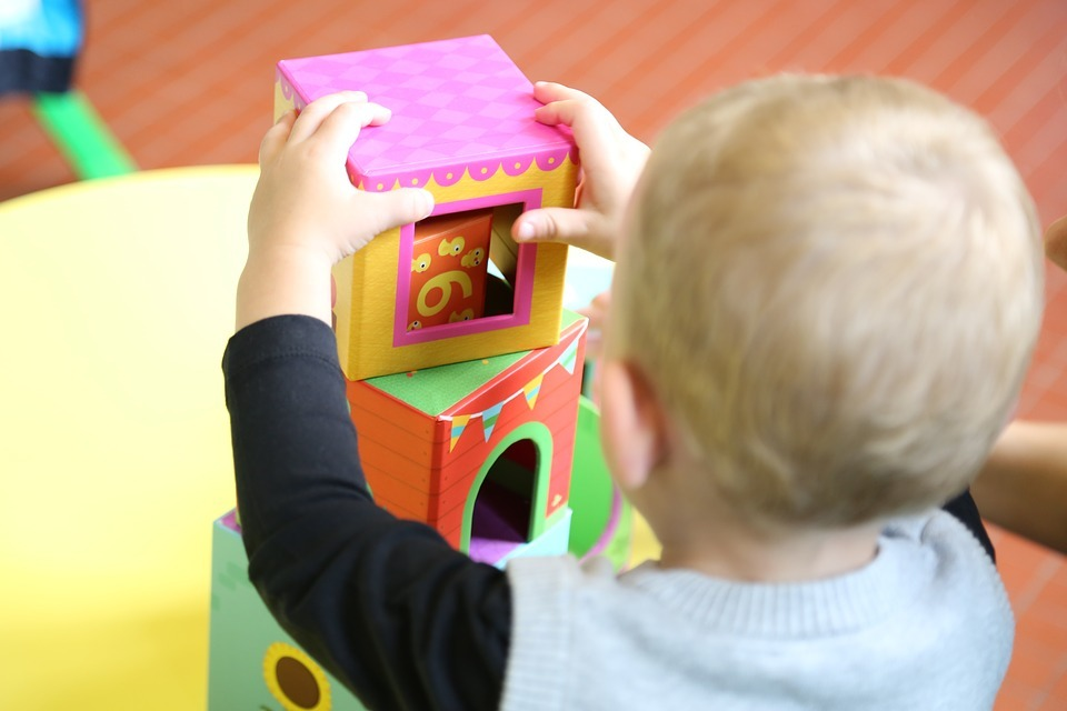 Stock image of child playing with toys at nursery