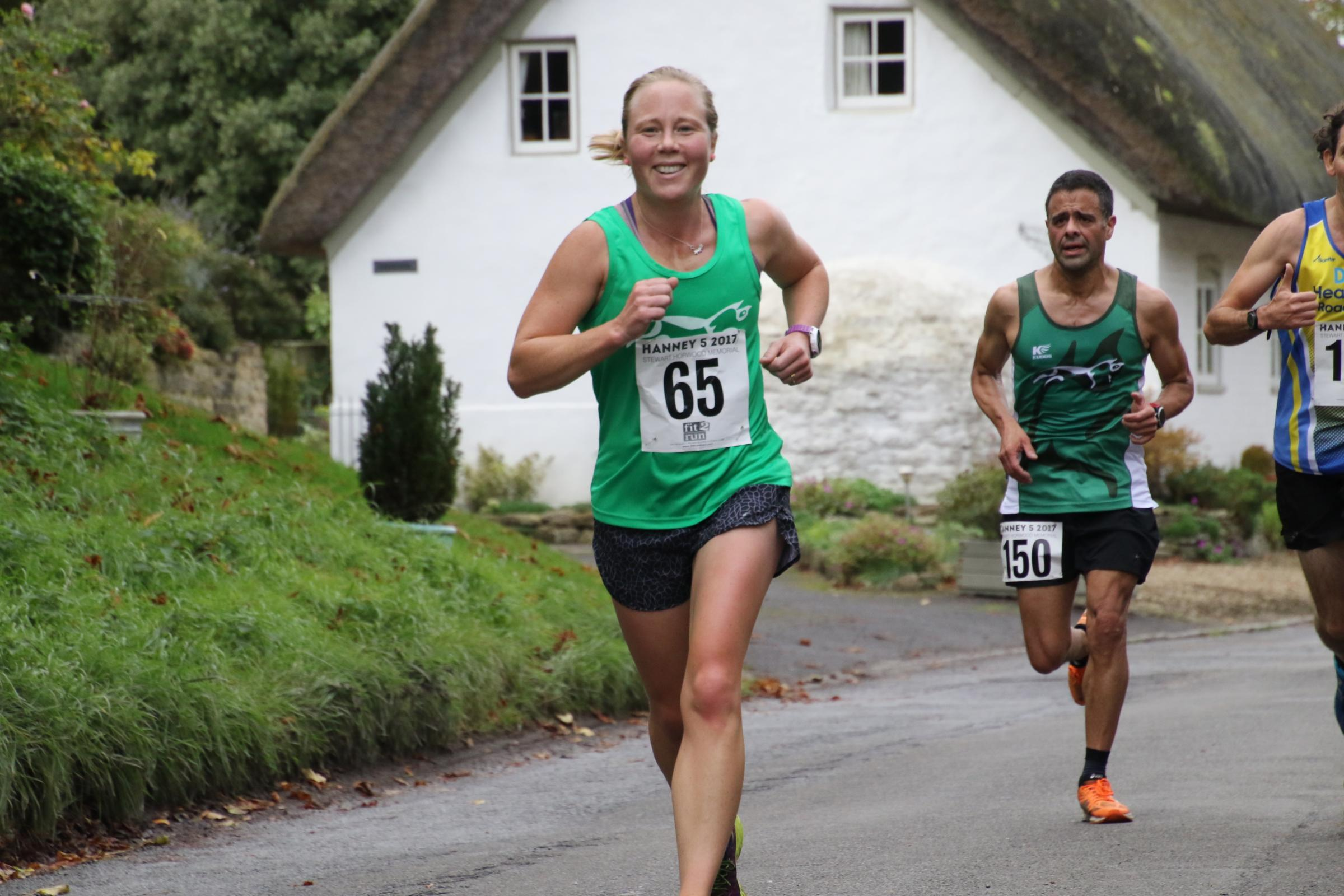 Clare Mowforth, of White Horse Harriers, is all smiles as she finishes as the top female at the Hanney 5 Picture: Barry Cornelius.