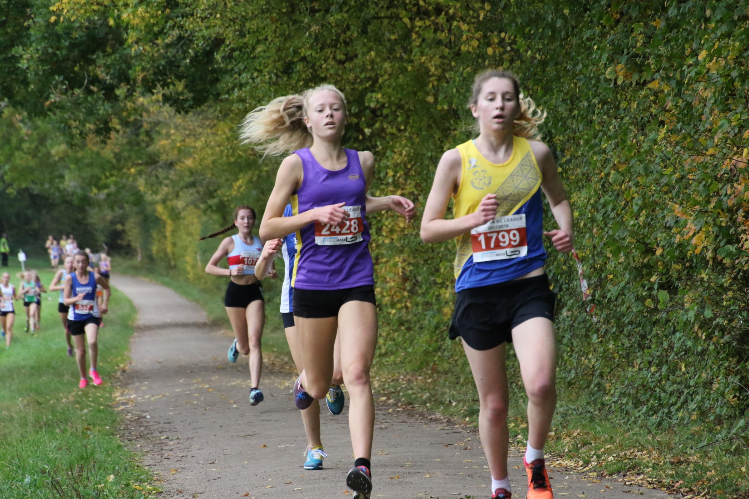 Radley's Rachel Burton (left) on her way to finishing third in the under 17 race in the first round of the Chiltern League Picture: Barry Cornelius