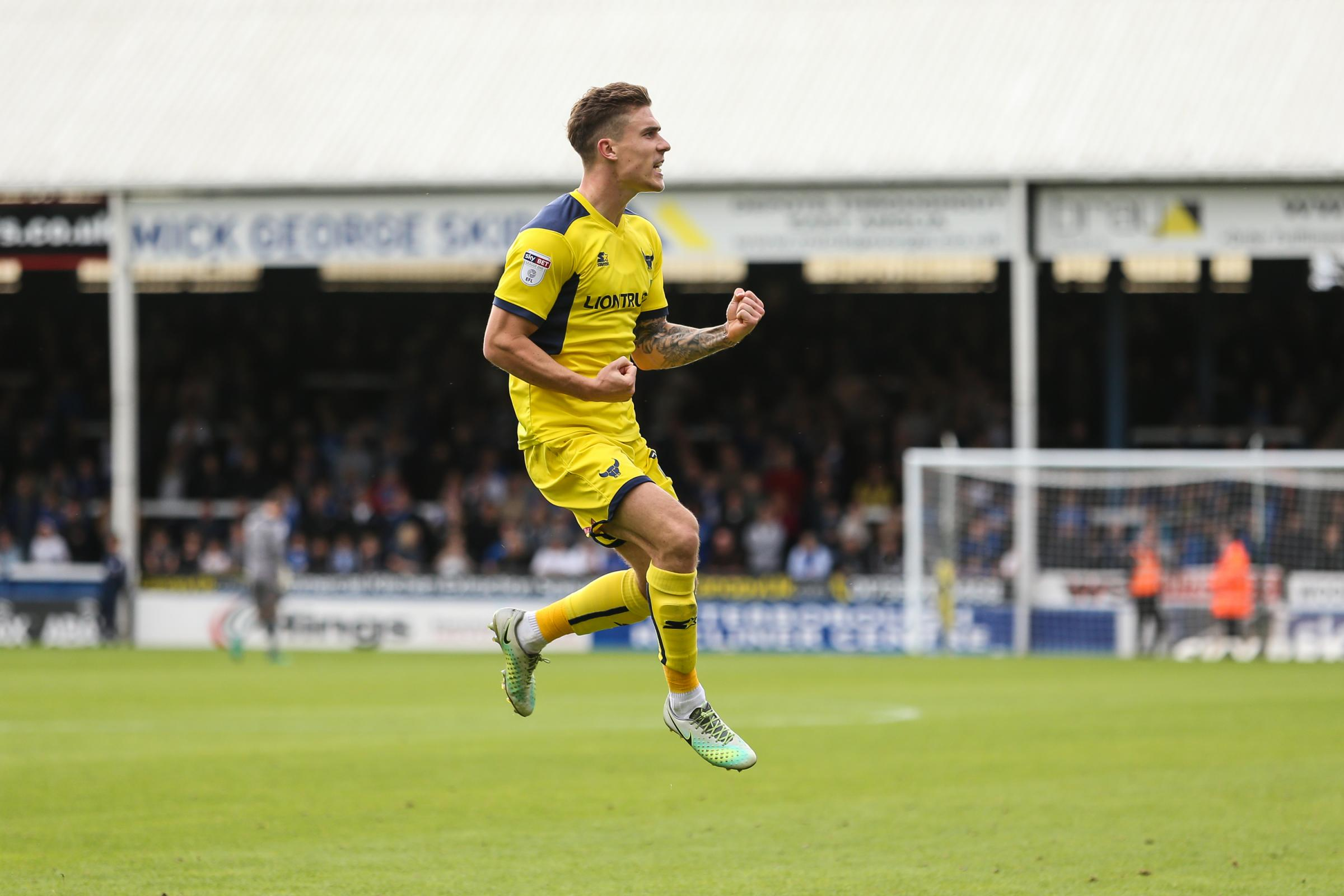 JUMPING FOR JOY: Josh Ruffels celebrates scoring at Peterborough United in September, which got him one step closer to the all-important ten goal target Picture: David Horn