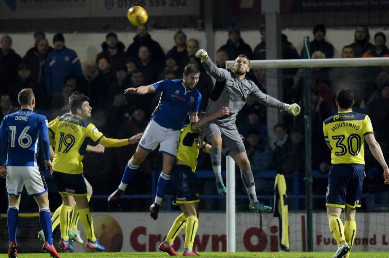 Oxford United goalkeeper Simon Eastwood punches clear  Picture: David Fleming