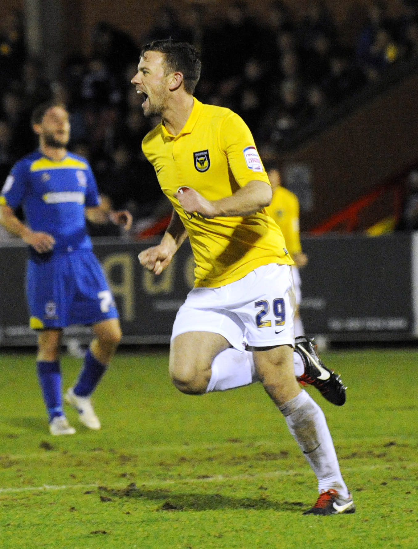 GIFT: Tom Craddock celebrates after pouncing on a mistake to score against AFC Wimbledon during United's perfect Christmas in 2012